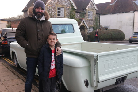 hants: 26TH DECEMBER 2016,WICKHAM,HANTS: A father and son at an old retro classic car show in wickham, england on the 26th december 2016