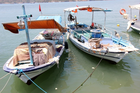 31ST MAY 2017, FETHIYE, TURKEY: Fishing boats moored along the promenade at Fethiye in Turkey, 31st may 2017 Editorial