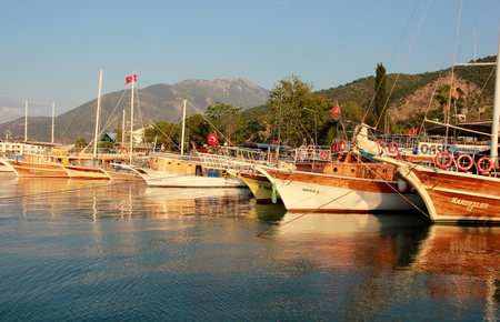 FETHIYE,TURKEY,31ST MAY 2017 :  Turkish pleasure boats moored during early evening in the bay at Fethiye, Turkey , 31st may 2017 Editorial