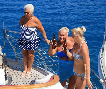 man drinking water: FETHIYE, TURKEY,17th july 2017,: English tourists on a bout trip around the bays of fethiye in Turkey,17th july 2017