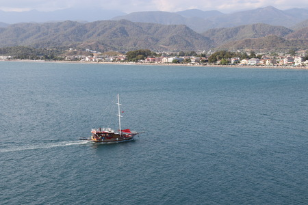 28TH JULY 2017: Boats motoring in the calm waters at calis,fethiye in turkey ,28th july 2017