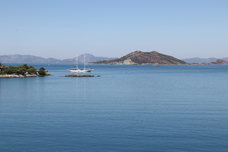 A view of a sailing boat and mountains in bays around fethiye in turkey