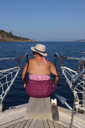 An english lady relaxing while on a boat trip around the bays at fethiye in turkey, 2017 Stock Photo