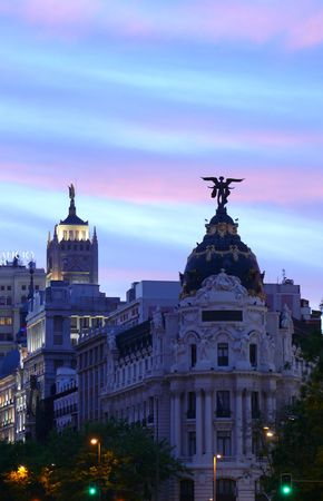 landmark buildings of Madrid just before night spotlights are lit photo
