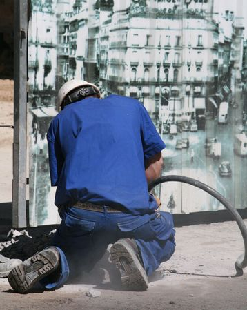 worker using a hammer drill in Madrid Stock Photo - 1006105