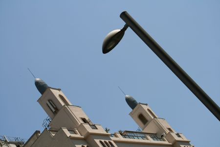 classic roof of Madrid Gran Via in perspective with lamppost photo