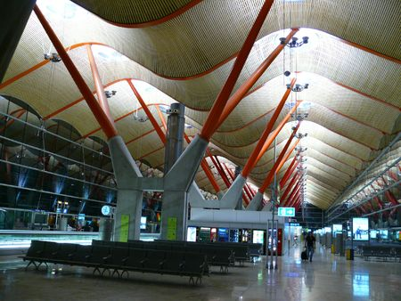 futuristic pillars of airport ceiling that looks like a wave