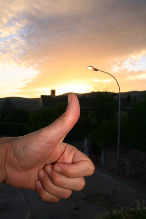 optimist hand close to twilight