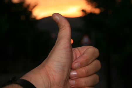 optimist: optimist hand in twilight Stock Photo