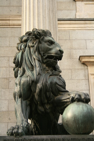 roaring lion of Spanish Parliament forged with bronze from cannons