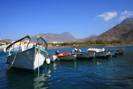 fishing boats anchored in Saint Nichols port in Canary Islands Stock Photo - 1599302