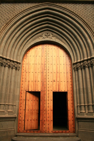 centenarian: wood and gold gates to cathedral