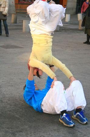 acrobats in street Stock Photo