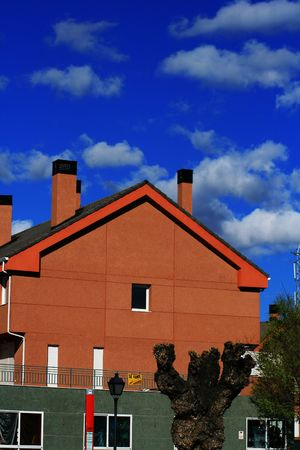 modern construction wall against cold blue sky and clouds Stock Photo