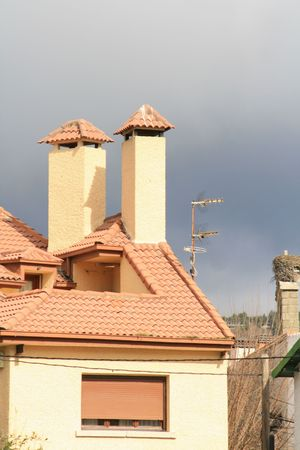 roof and chimney in contrast with sky
