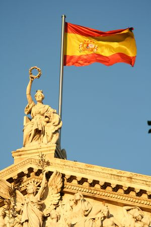 sculpture and flag atop of national library of Spain