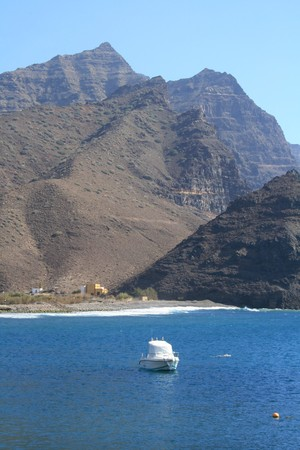 blue bay and boat in san nicolas port of canary islands tropics