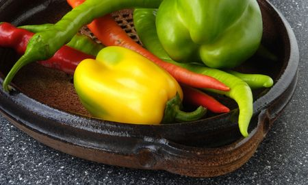 Vegetables, ceramic dish and chillies