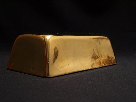 gold ingot: Gold ingot Stock Photo