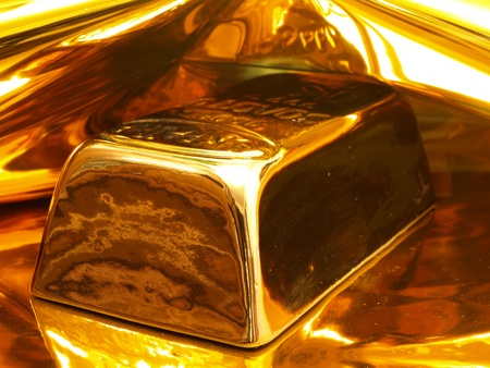 gold ingot: Gold ingot Stock Photo