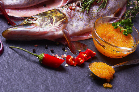 Fish pike with spices and vegetables, and caviar Stock Photo