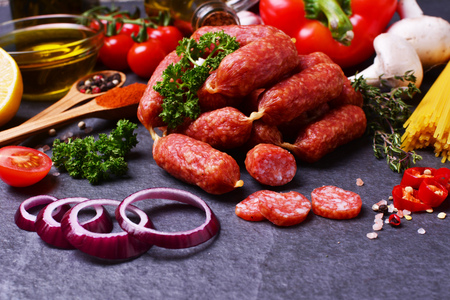 Sausage with salami with spices and vegetables