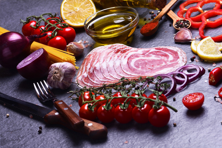 Italian bacon with spices and vegetables Stock Photo