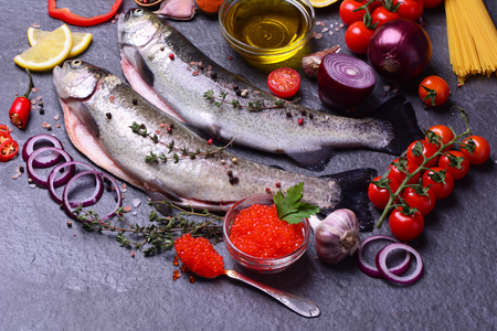 Fish trout and red caviar Stock Photo