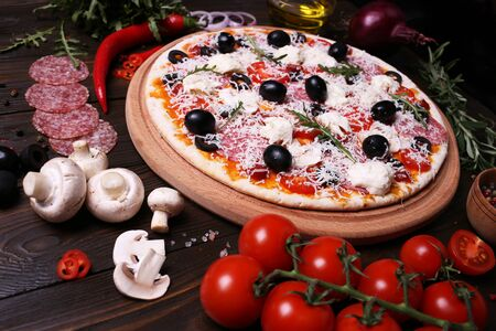 Italian pizza with the best products, with tomatoes, mozzarella cheese, mushrooms and olives
