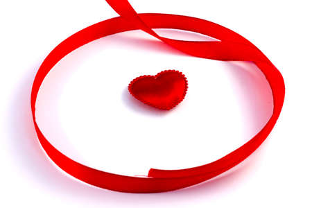 sellotape: Red tape loop with small heart on a white background
