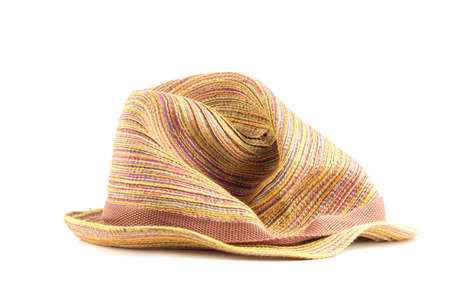 full face: Crumpled straw hat color full face on a white background