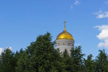 Russian church dome against the blue sky and clouds trees photo