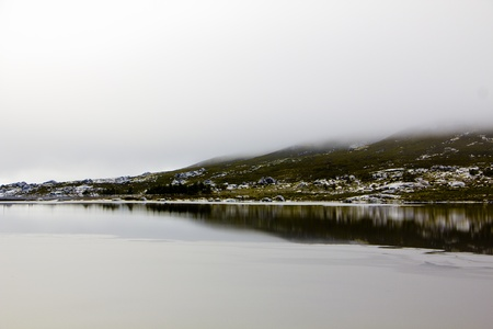 Landscape with lake, rocks and fog in Serra da Estrela – mountain range in Portugal (Mountain Range of the Star)
