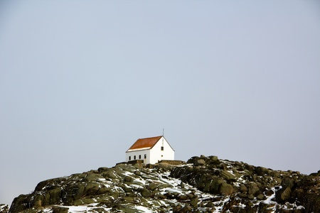 Small house on top of a mountain Stock Photo
