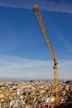 Construction Crane over ancient city Lisbon Stock Photo