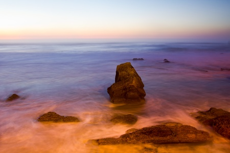 Sunset on the rocky coast in Portugal