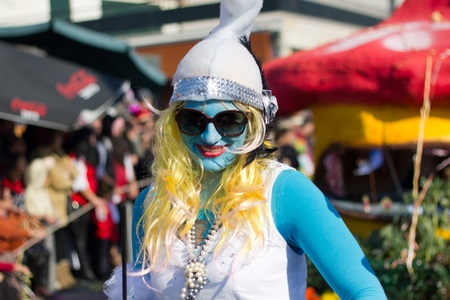 SESIMBRA, PORTUGAL - FEBRUARY 19: Girl dressed up as a Smurph in the Carnival on February 19, 2012 in Sesimbra, Portugal.