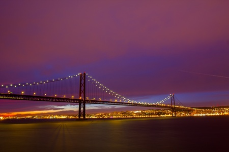 Suspension Bridge in Lisbon at sundown Stock Photo