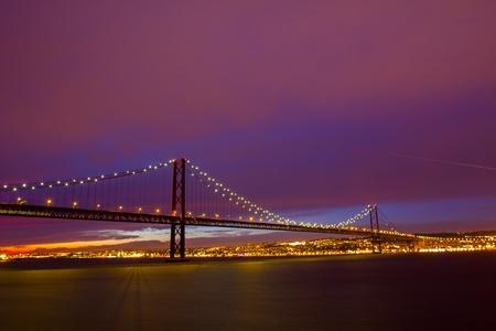 Suspension Bridge in Lisbon at sundown Stock Photo