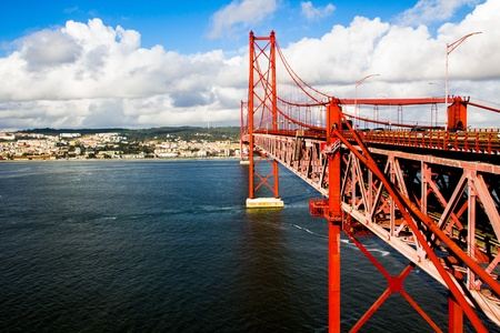 Red Suspension metallic Bridge in Lisbon Stock Photo