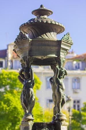 Rossio square statue fountain at Baixa district in Lisbon, Portugal