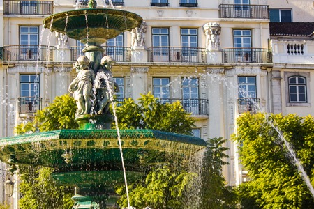 Rossio square with fountain located at Baixa district in Lisbon, Portugal Stock Photo