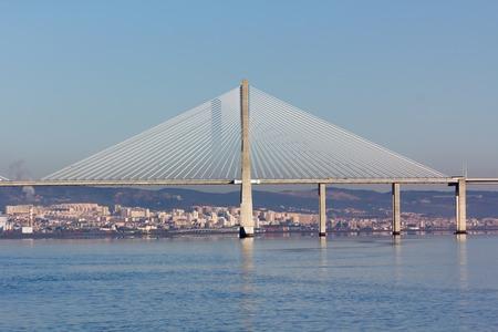 suspension bridge Vasco da Gama Bridge at sunset