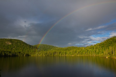 rainbow over the lake, Northern Ontario, Canada