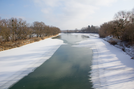 Winter river and trees landscape in Ukraine