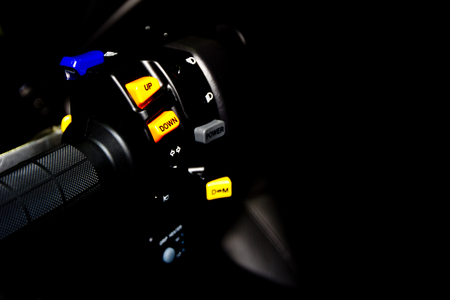 Yellow switch control up and down on motorcycle grip Stock Photo
