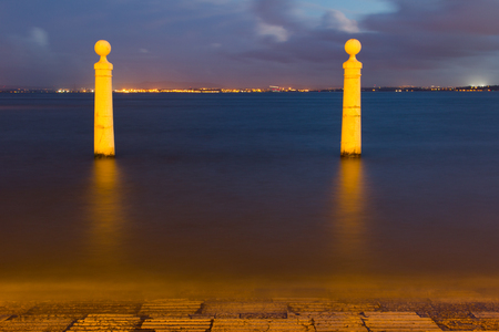 the tagus: Columns Pier, Portuguese: Cais das Colunas, by the Tagus river in Lisbon, Portugal.