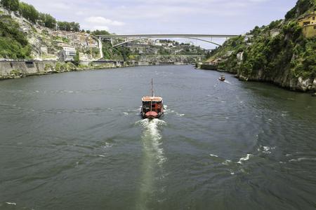 A view of Ancient city Porto, Infante Bridge, Douro River, boat