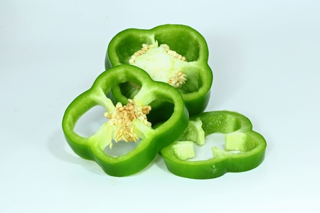 capsicums: Green bell chilli on isolate white