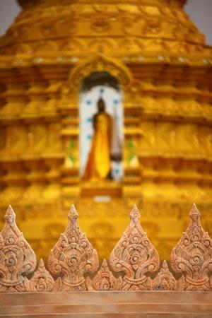 hanuman: Arts wall in front of image of buddha